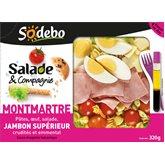 Salade Montmartre garnie de pâtes, oeuf, crudités, jambon, emmental sauce vinaigrette balsamiq...